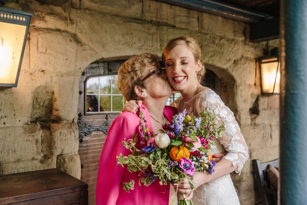 Nan kissing bride, Saxon Mill wedding