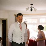 Father seeing bride in her wedding dress for the first time