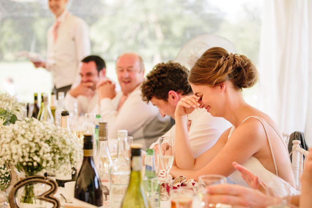 Bride cringing at the wedding speeches