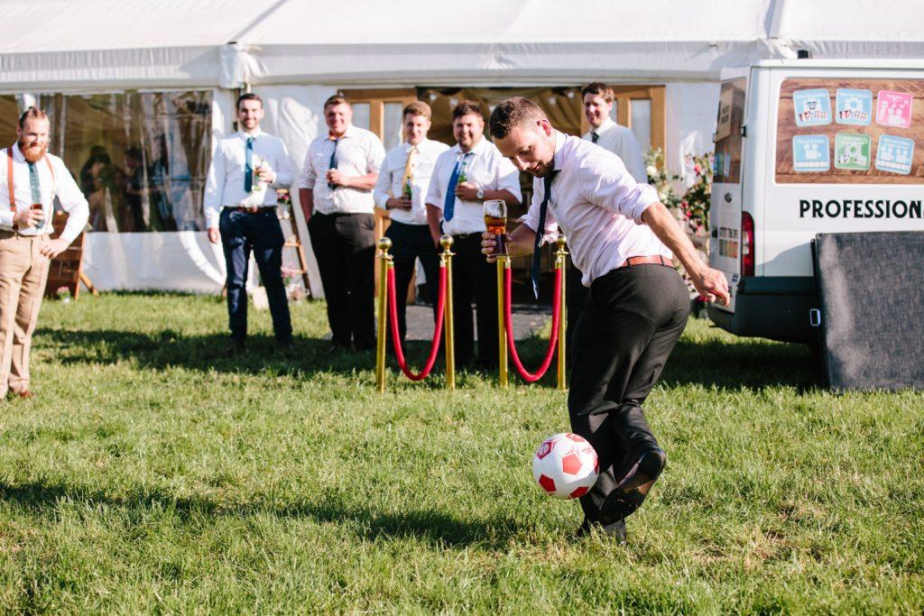 Man playing football at a wedding