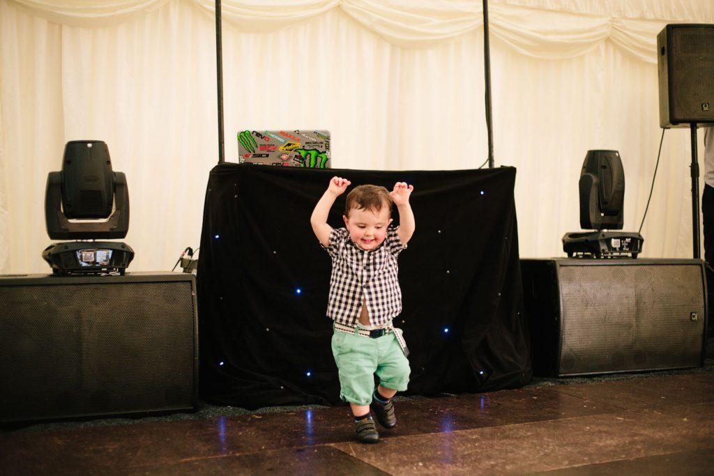 child dancing on wedding dance floor