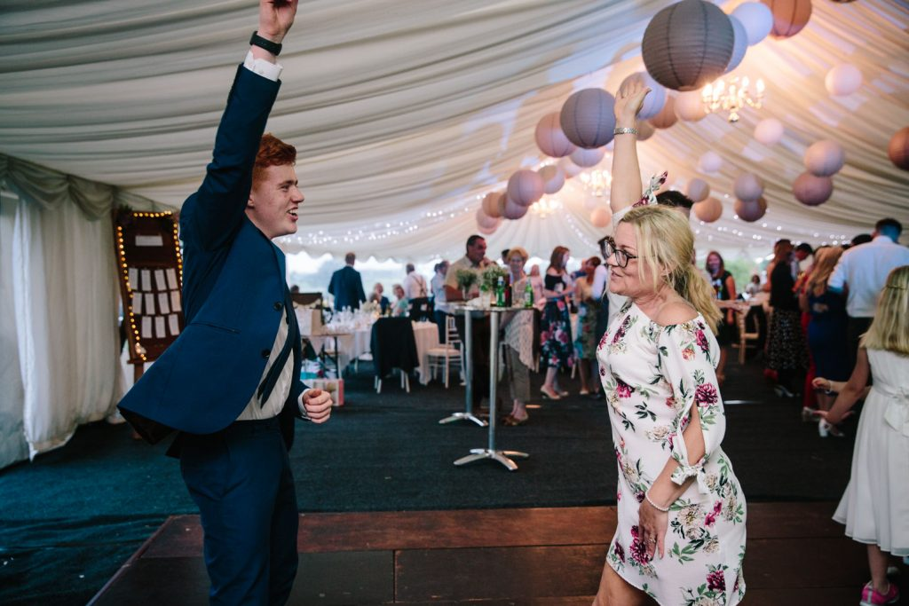 wedding guests dancing at marquee wedding