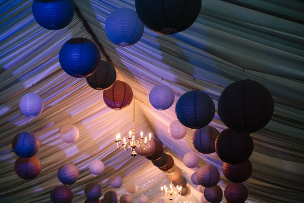 paper lanterns hanging in a marquee wedding