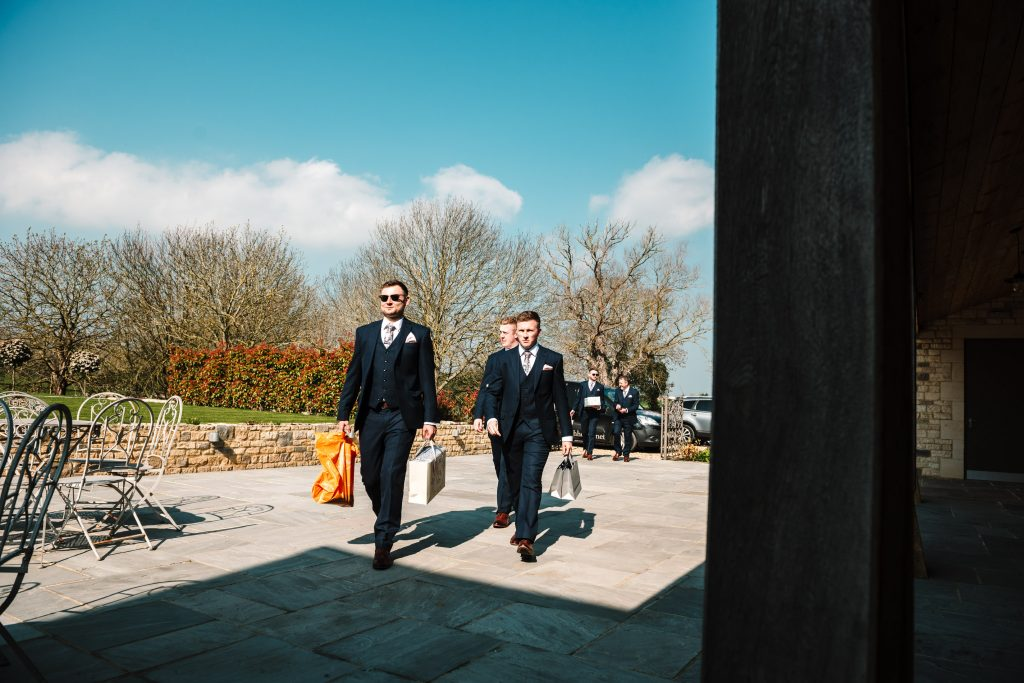 Groom and best man arriving at blackwell grange wedding venue