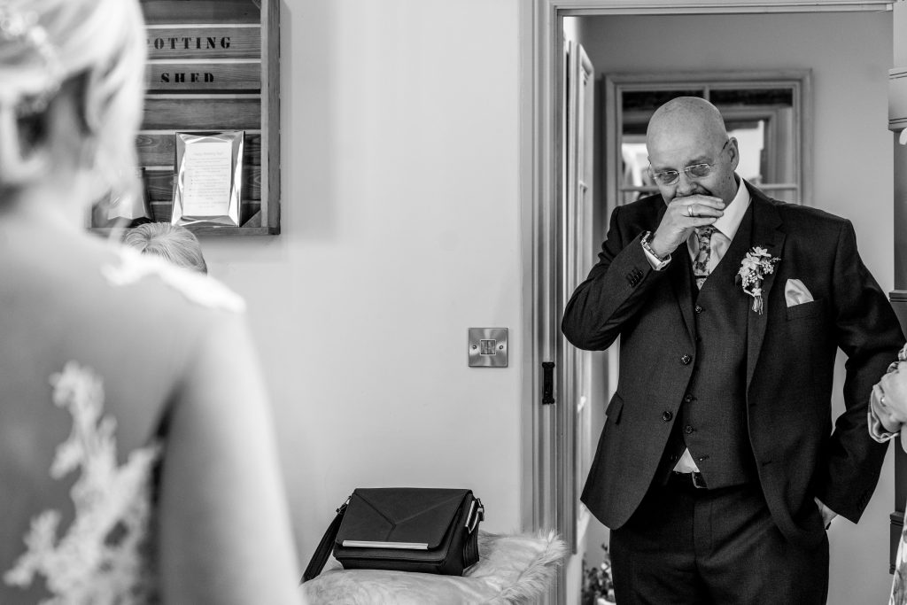 dad crying as he sees his daughter in her wedding dress at blackwell grange