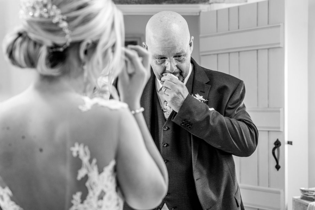 Dad and daughter crying as he sees her in her wedding dress at blackwell grange