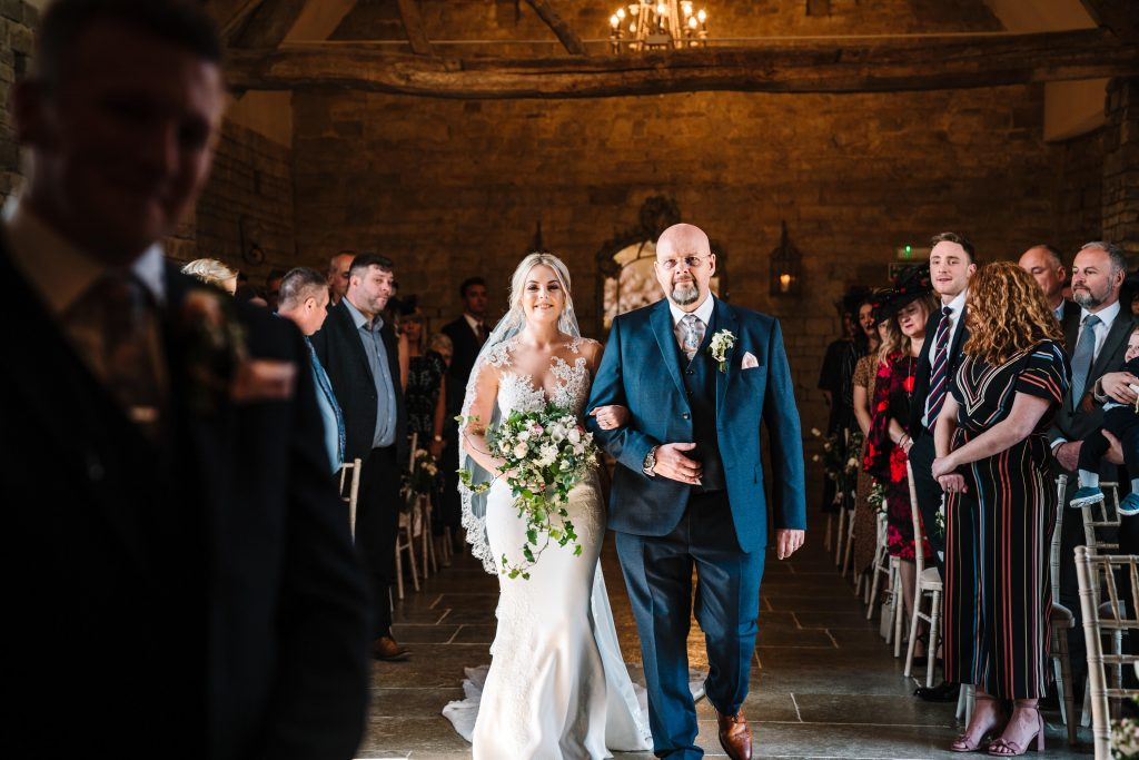 bride walking down the aisle with her dad at blackwell grange