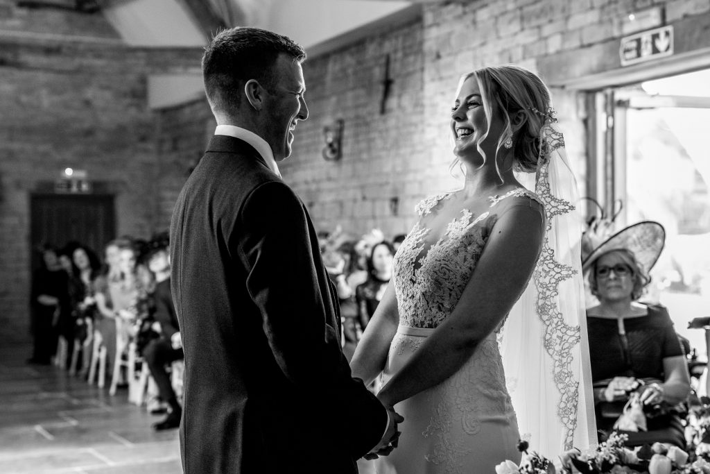 bride and groom laughing during their wedding ceremony at blackwell grange