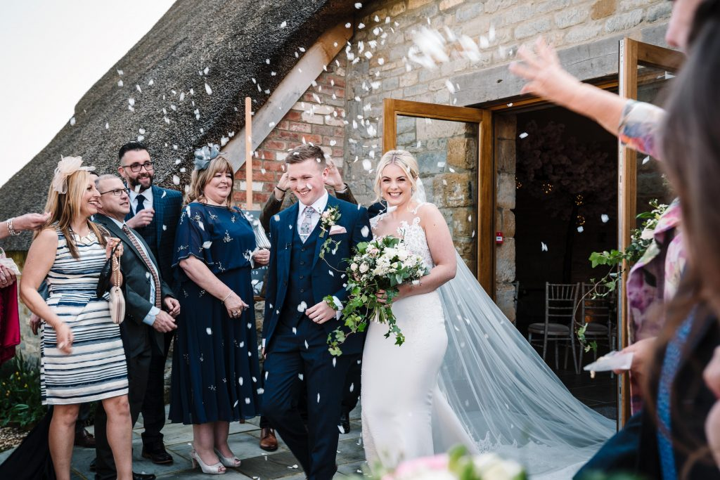 confetti thrown over bride and groom at blackwell grange wedding