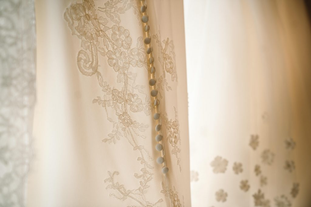 buttons and lace detail on wedding dress