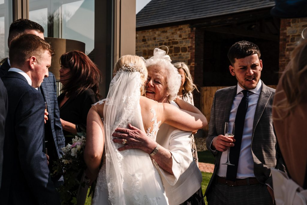 bride hugging grandma at wedding, blackwell grange