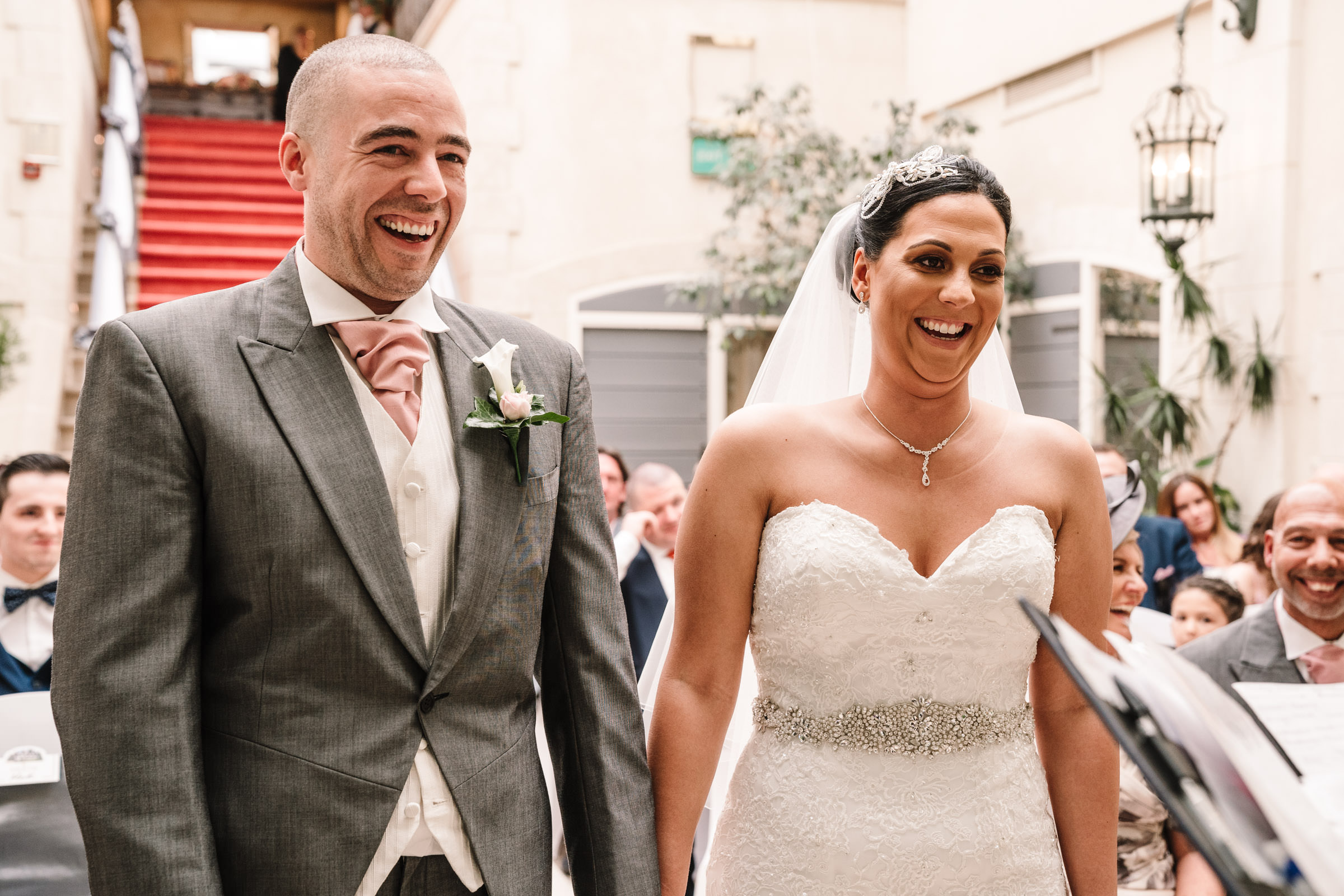 Bride & groom laughing during Nailcote hall wedding ceremony