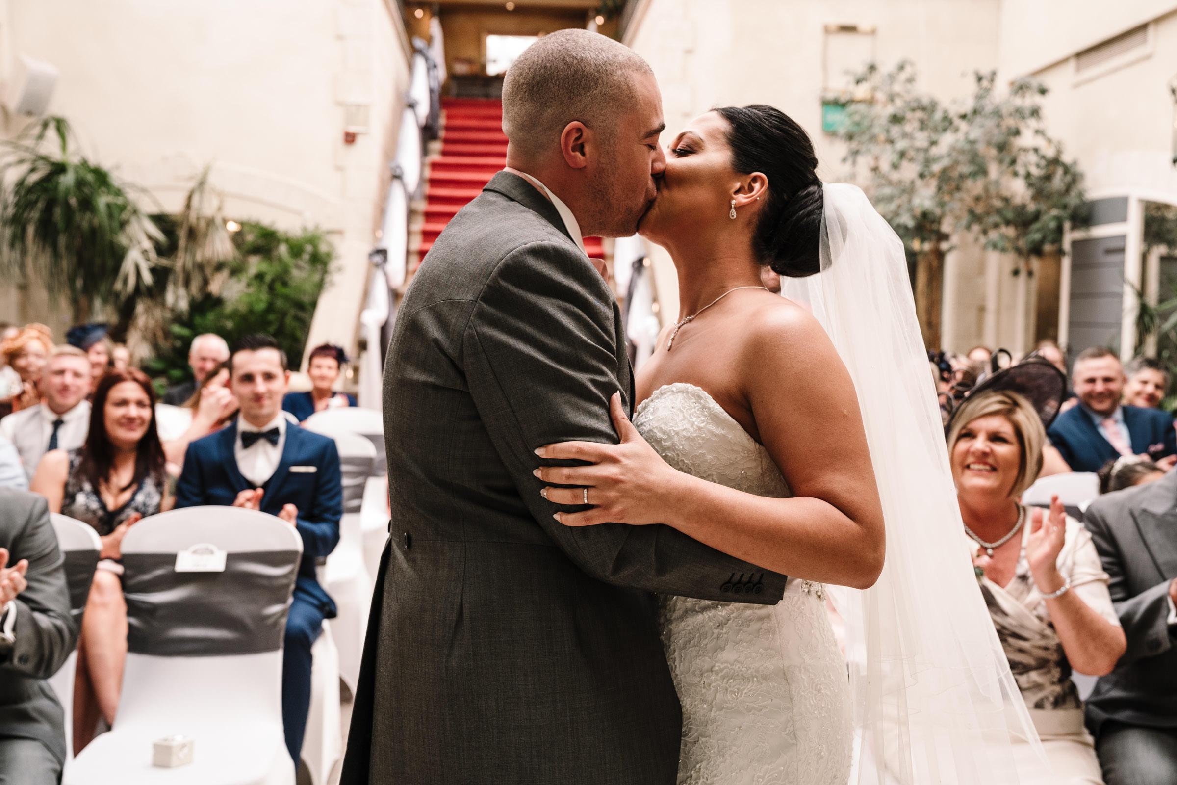 Bride and groom first kiss, Nailcote hall wedding