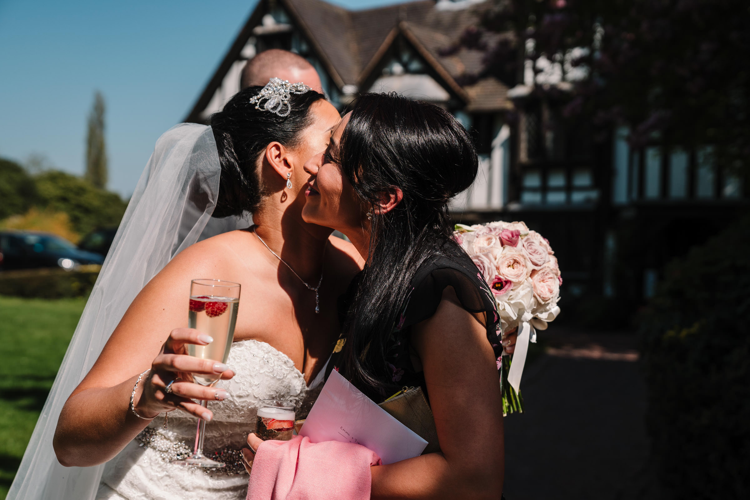 Bride greeting guests after wedding ceremony, nailcote hall