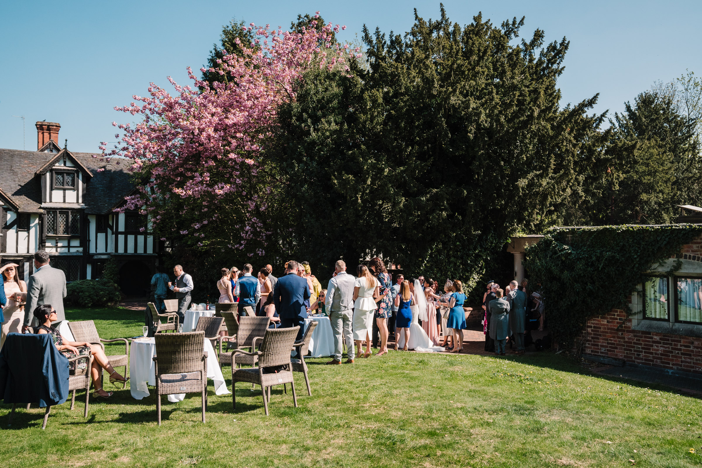 wedding guests on the lawn in the sunshine at Nailcote hall