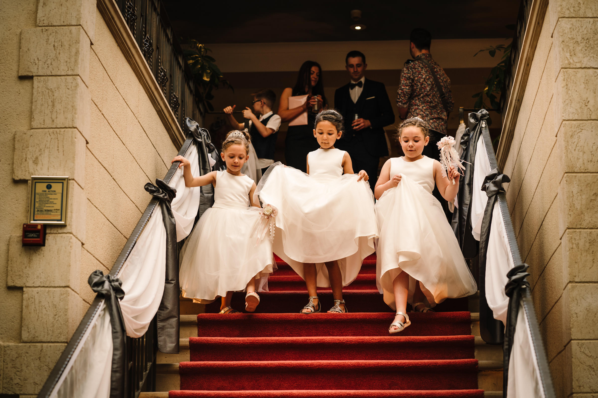 flower girls coming down the stairs at Nailcote hall wedding