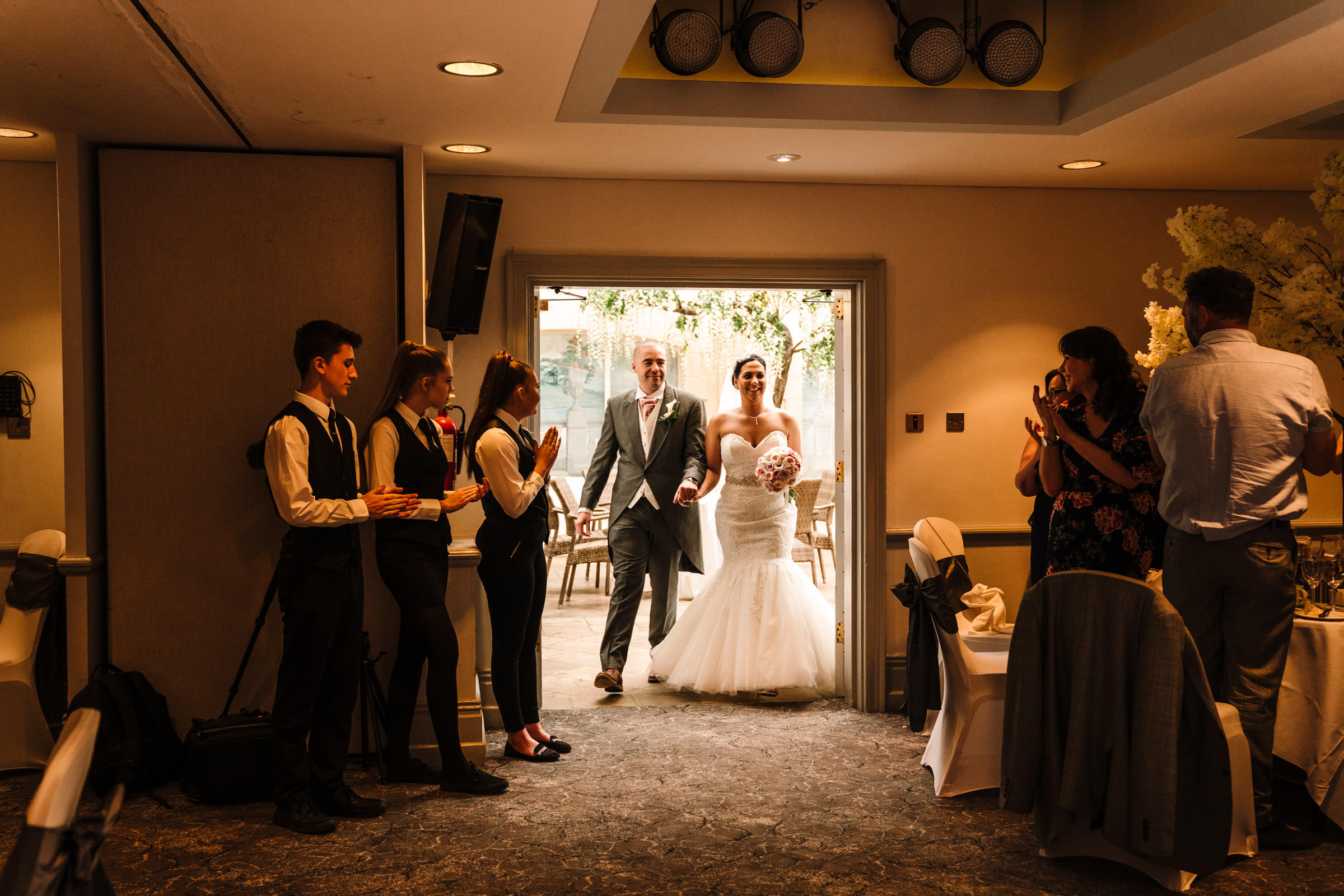bride and groom announced in to wedding breakfast at nailcote hall
