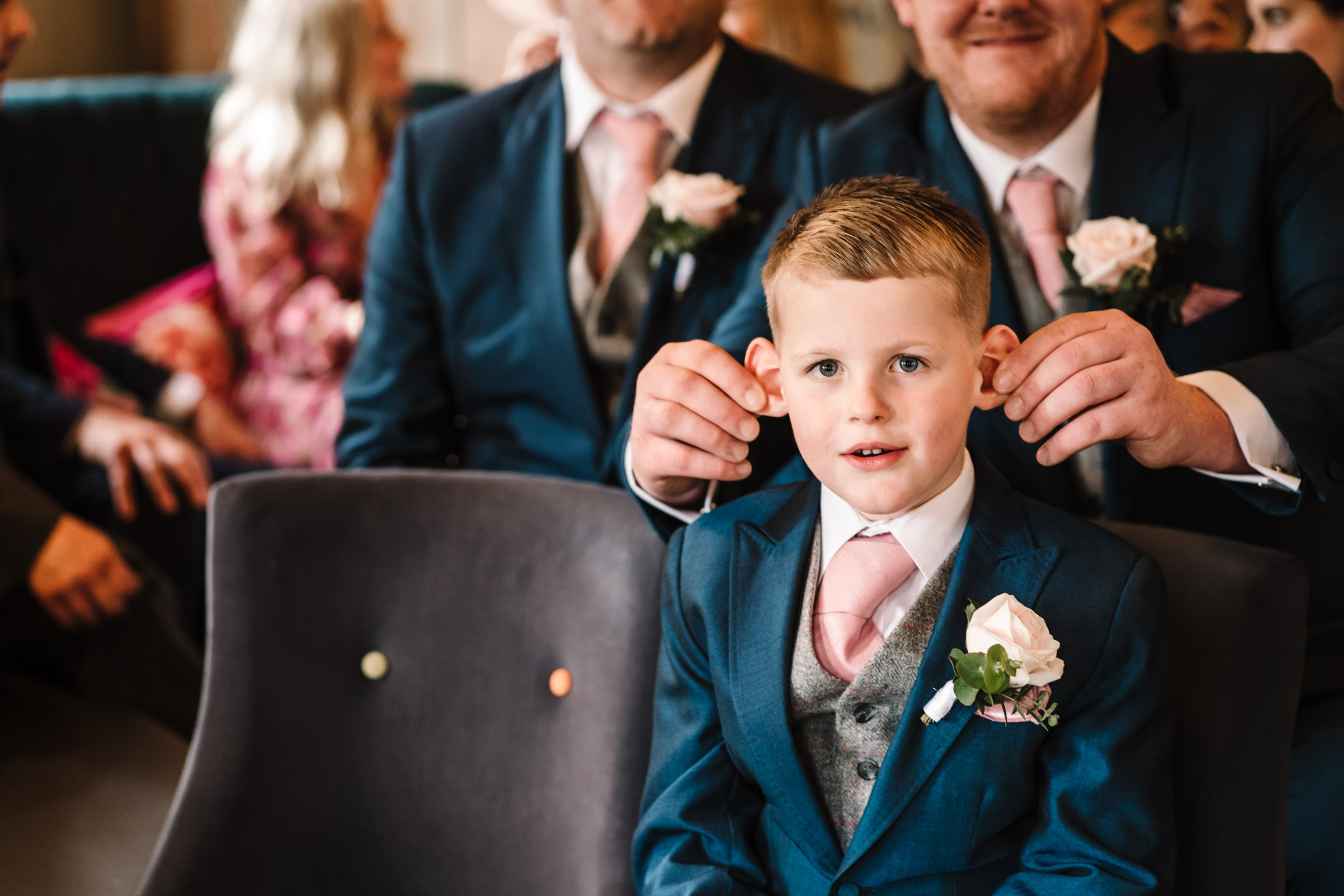 page boy waiting for wedding ceremony, royal arms hotel wedding