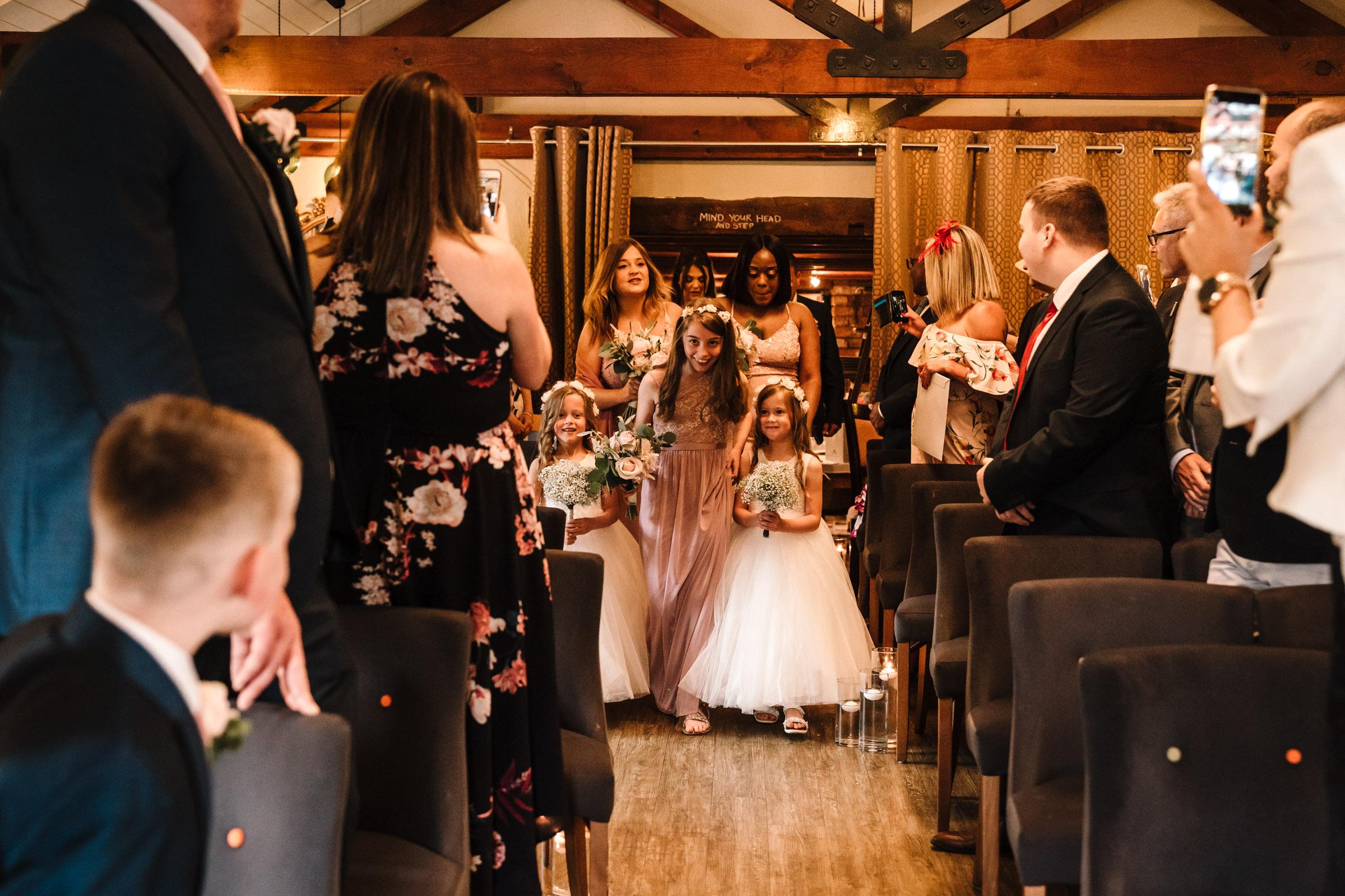bridesmaids walking down the aisle, royal arms hotel wedding