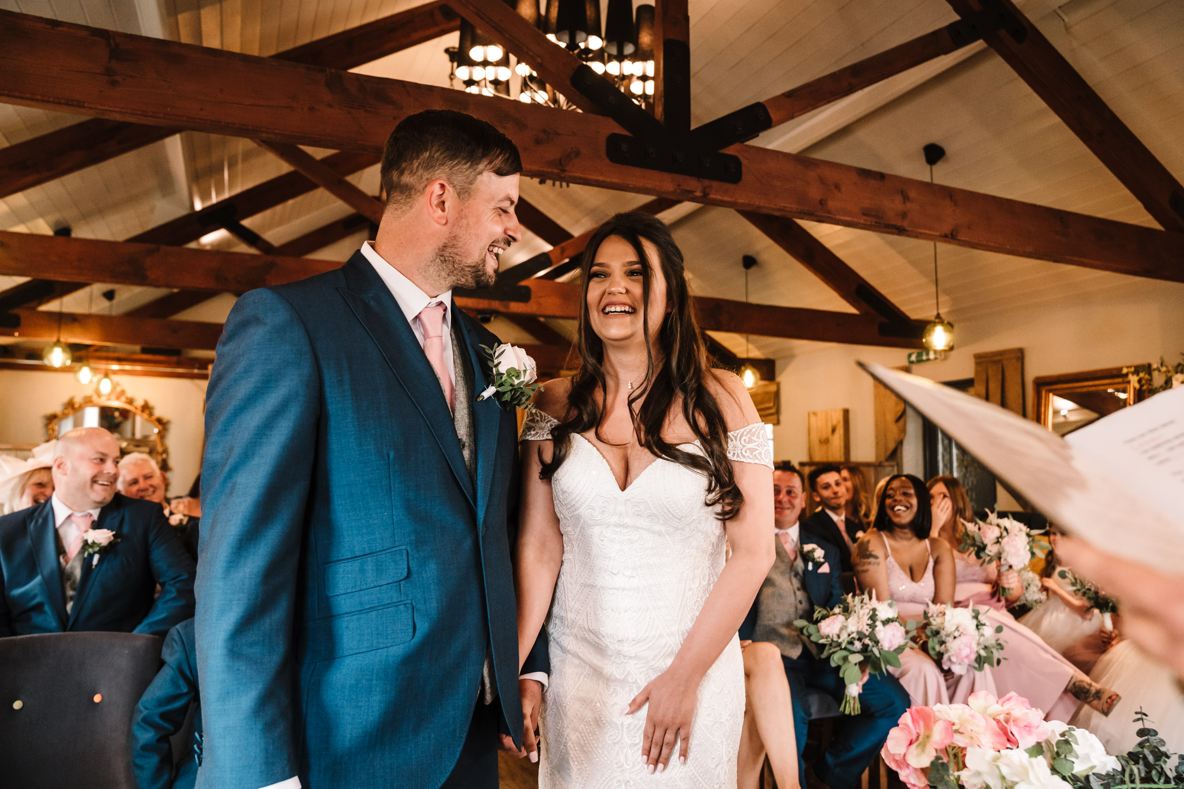 Bride and groom laughing during royal arms hotel wedding ceremony