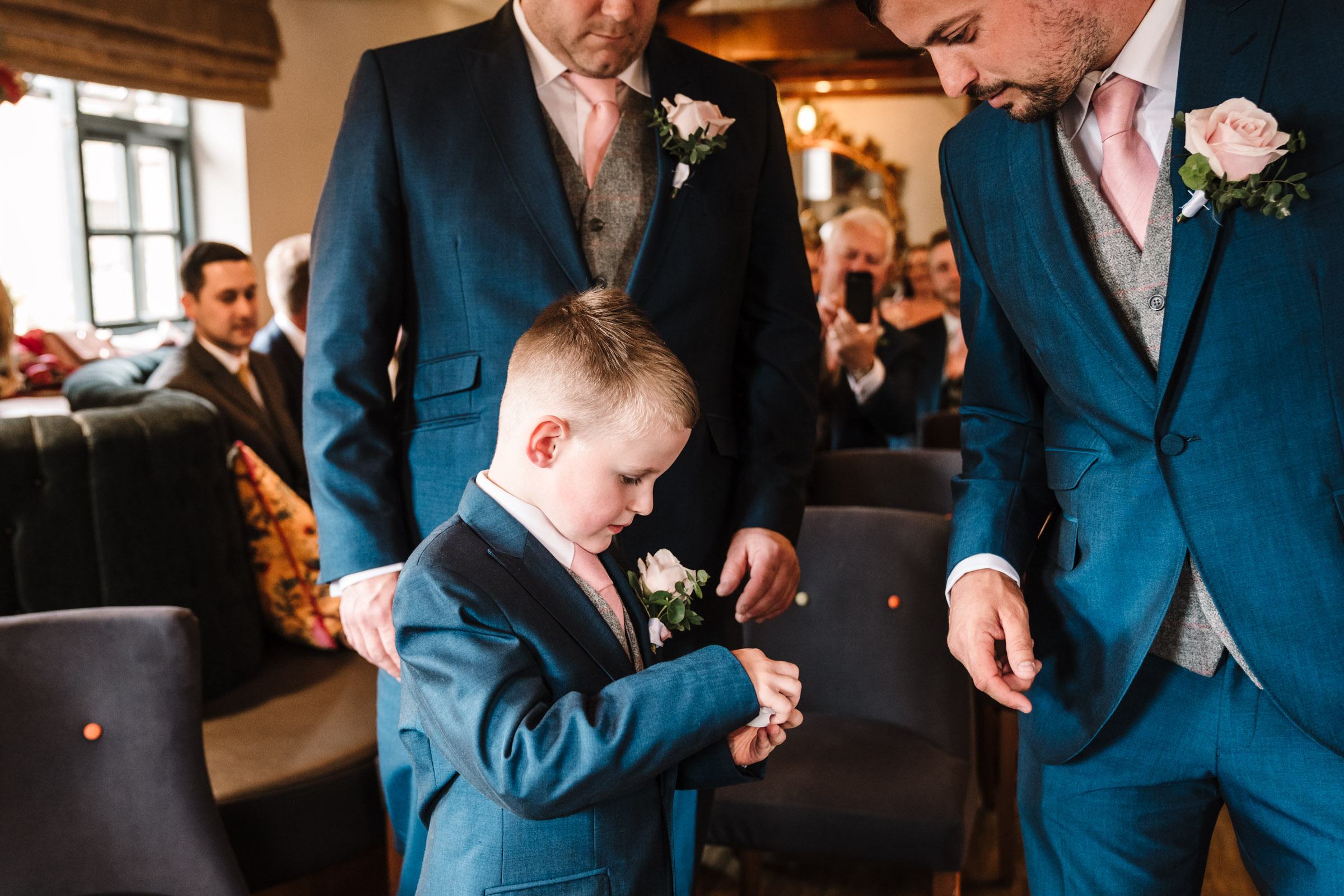 Page boy giving the groom the rings, royal arms hotel wedding