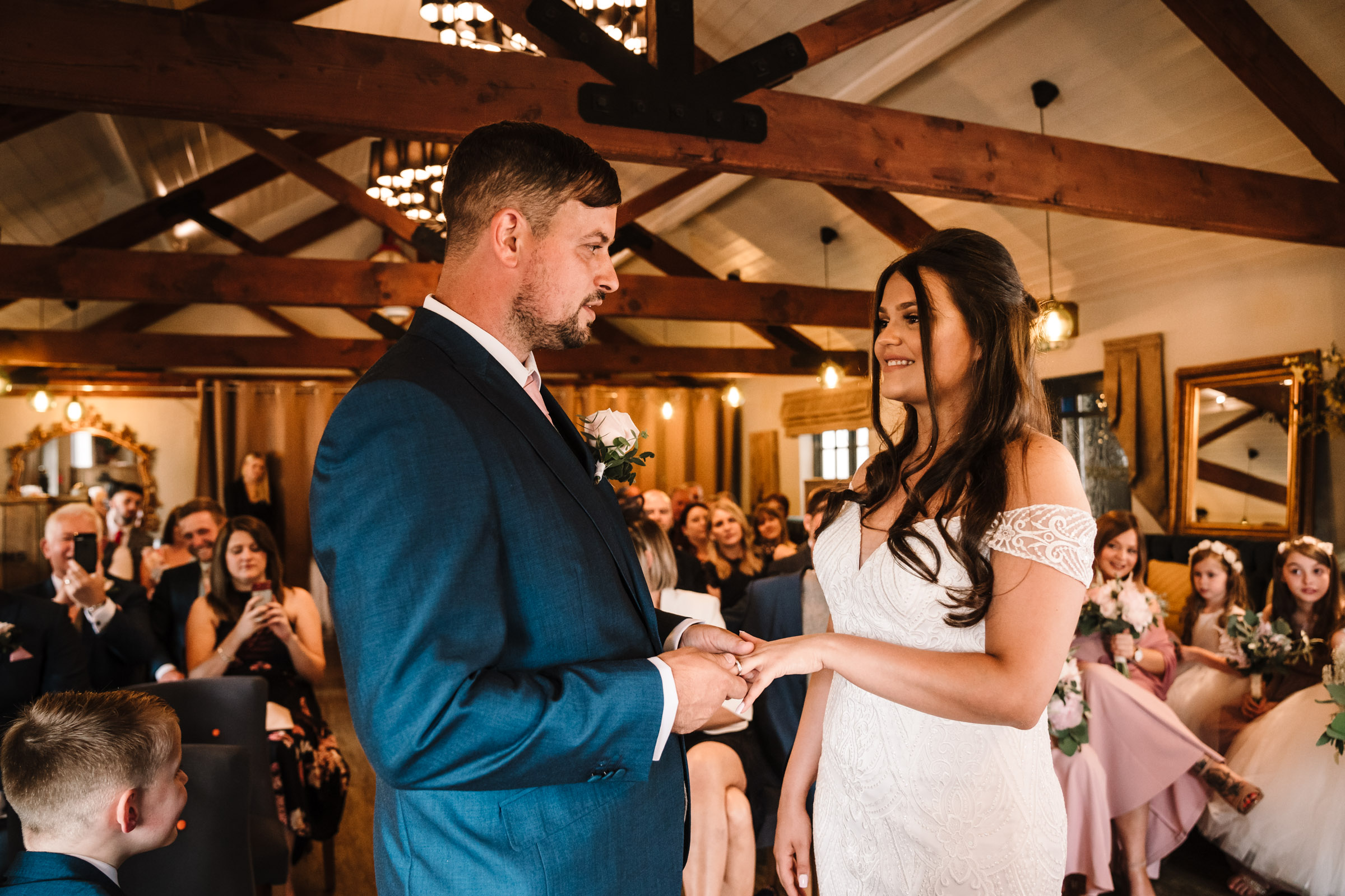 Brid mand groom exchanging rings during wedding ceremony