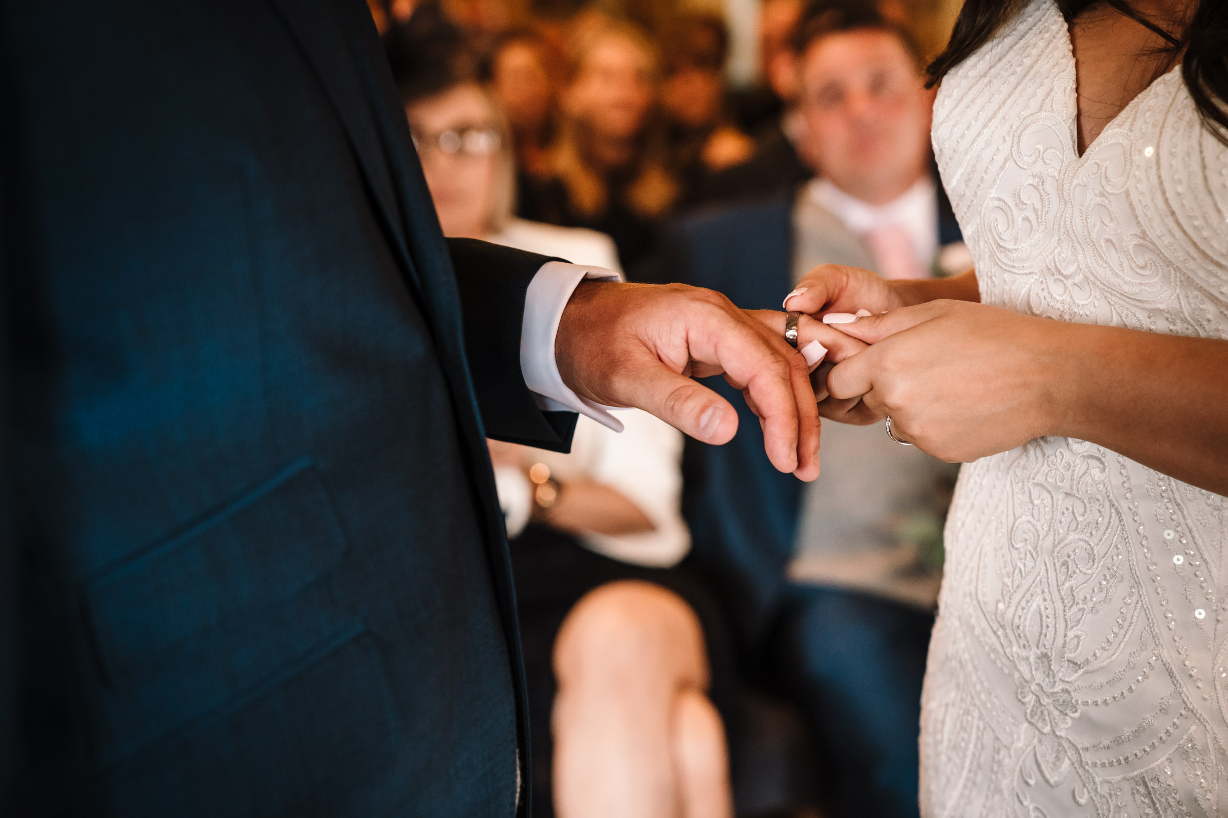 exchanging rings during royal arms hotel wedding ceremony