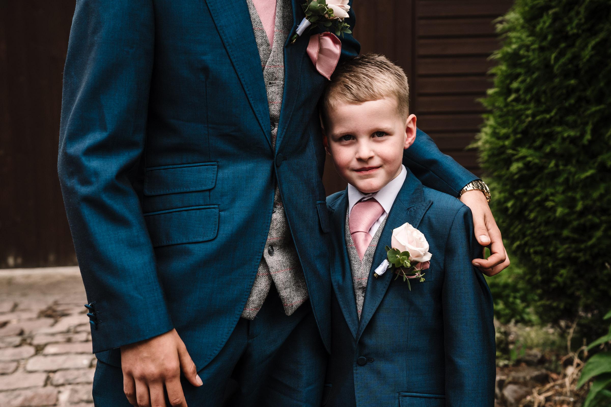 Page boy cuddling groomsmen, royal arms hotel wedding