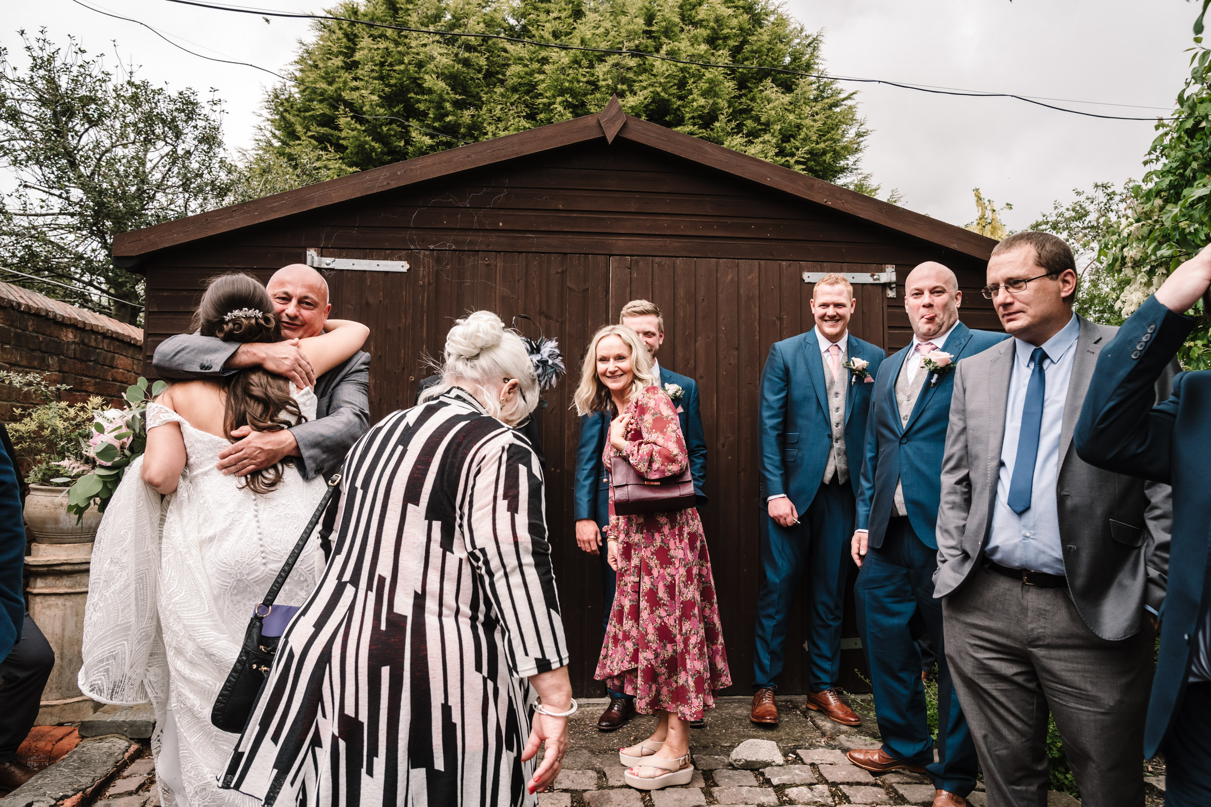 Wedding guests congratulating bride, royal arms wedding