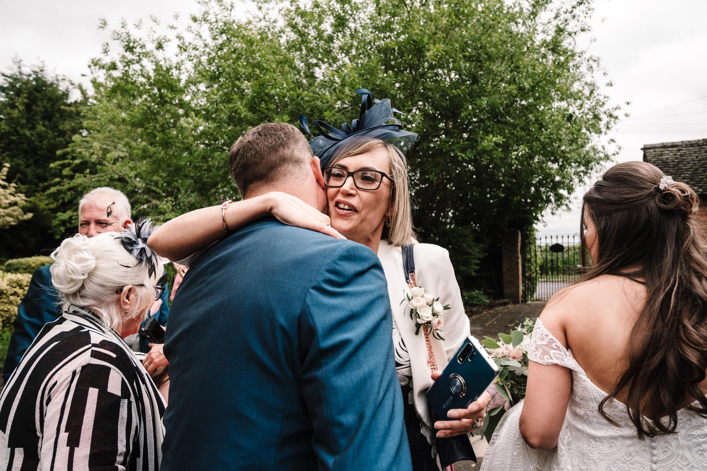 Mother of the bride congratulating groom, royal arms hotel wedding