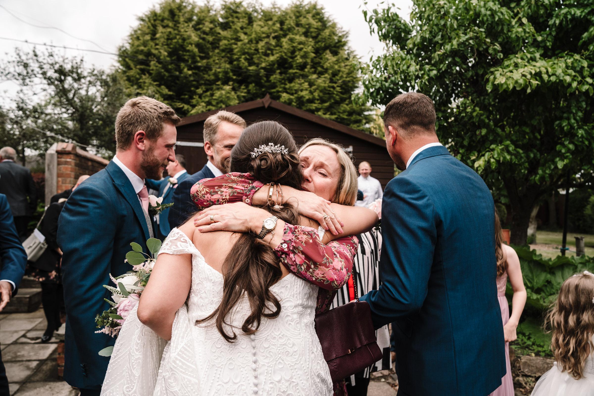 Guests congratulating bride after wedding ceremony