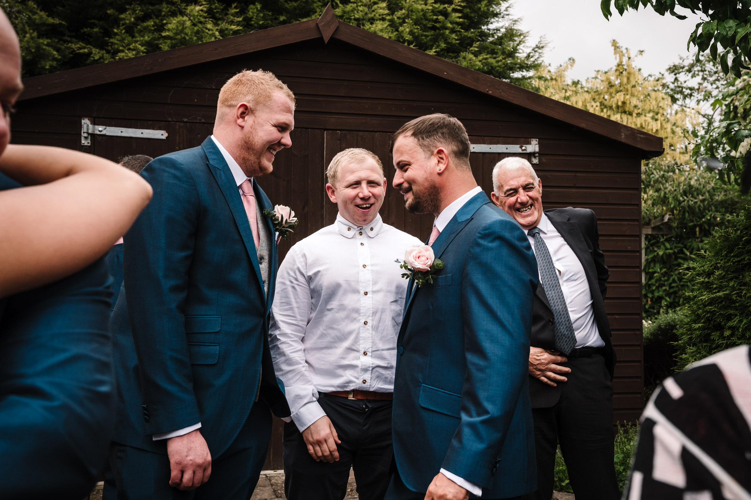 Groom with guests at royal arms hotel wedding
