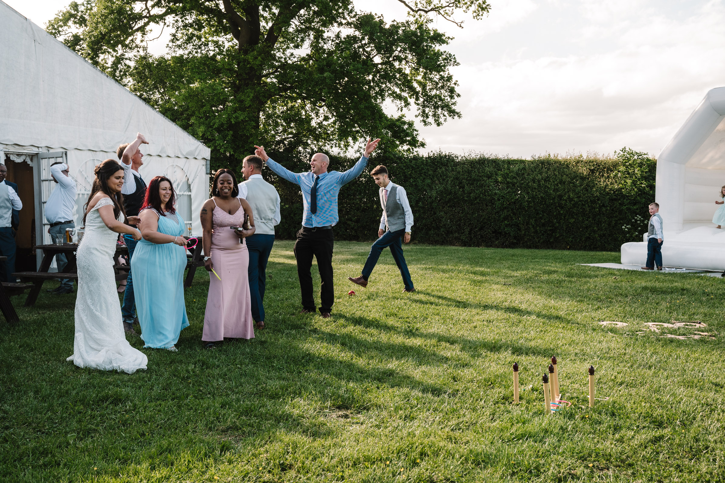 guests at royal arms hotel wedding, playing garden games