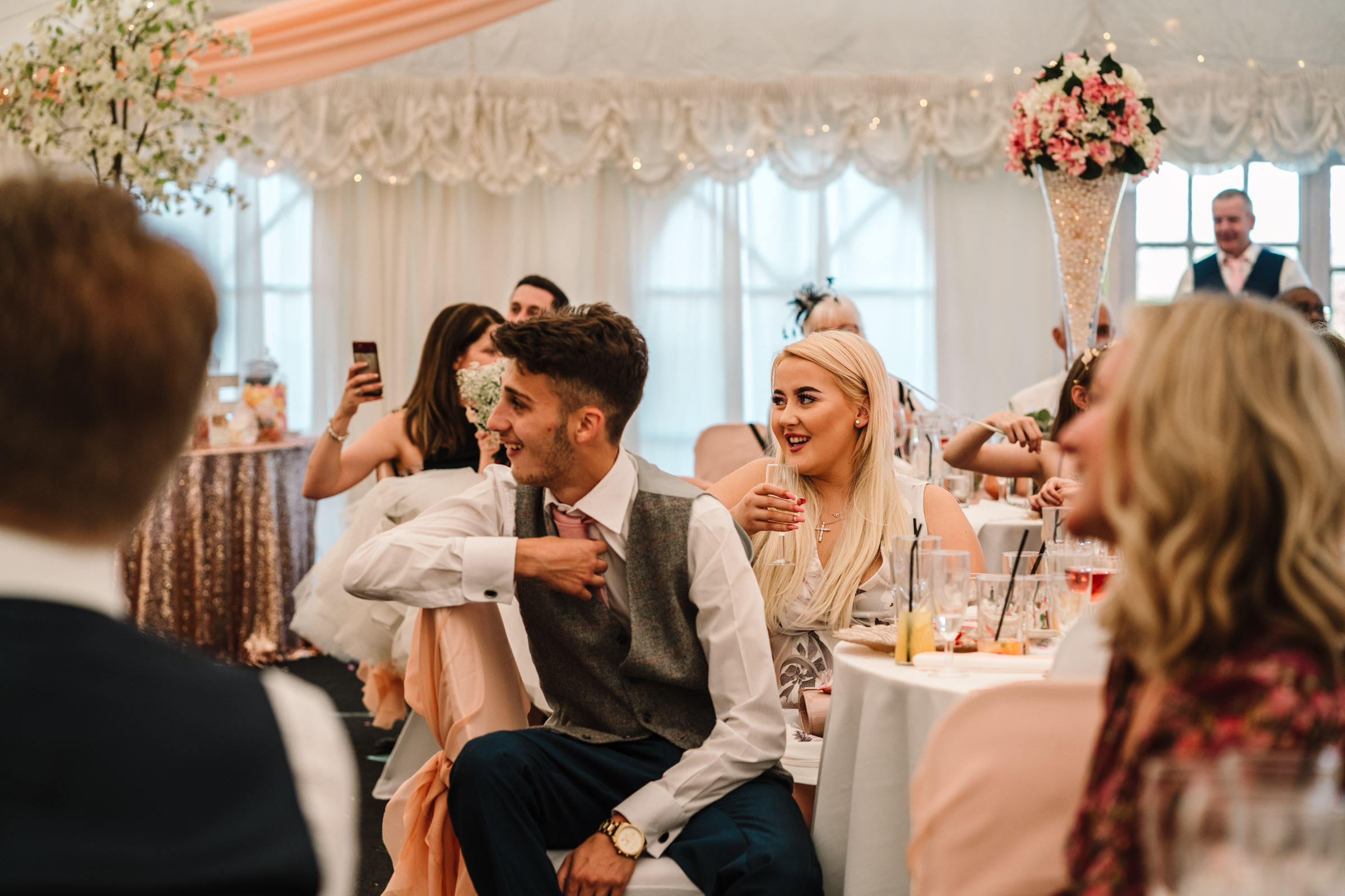 Guests laughing during speeches, royal arms hotel wedding