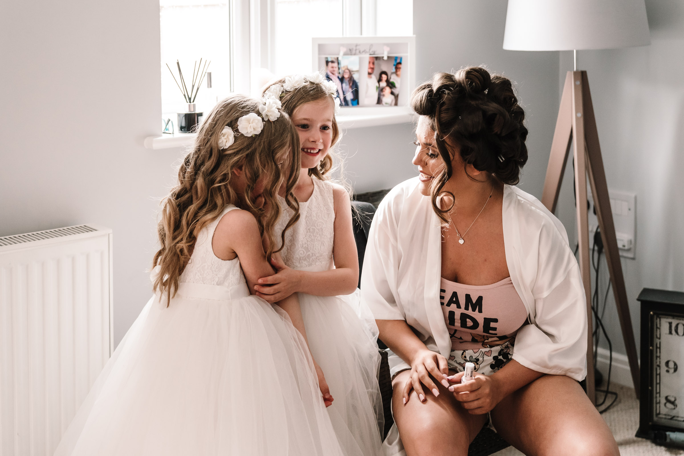 bride and flower girls during bridal prep