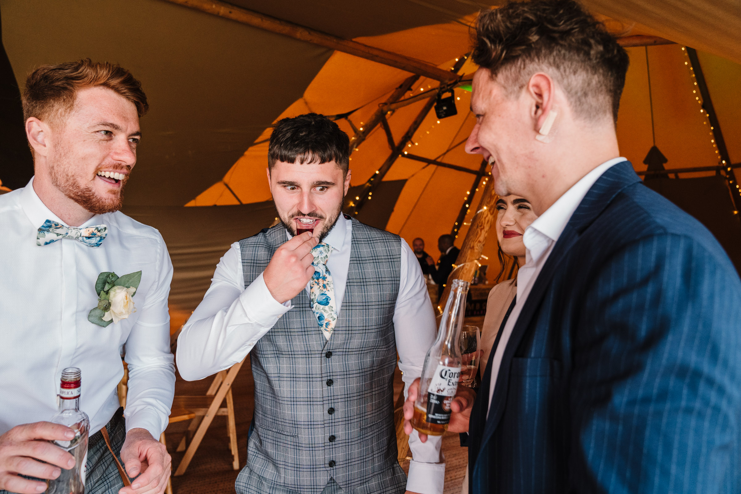 Groom and guests drinking shots, tipi wedding, kenilworth