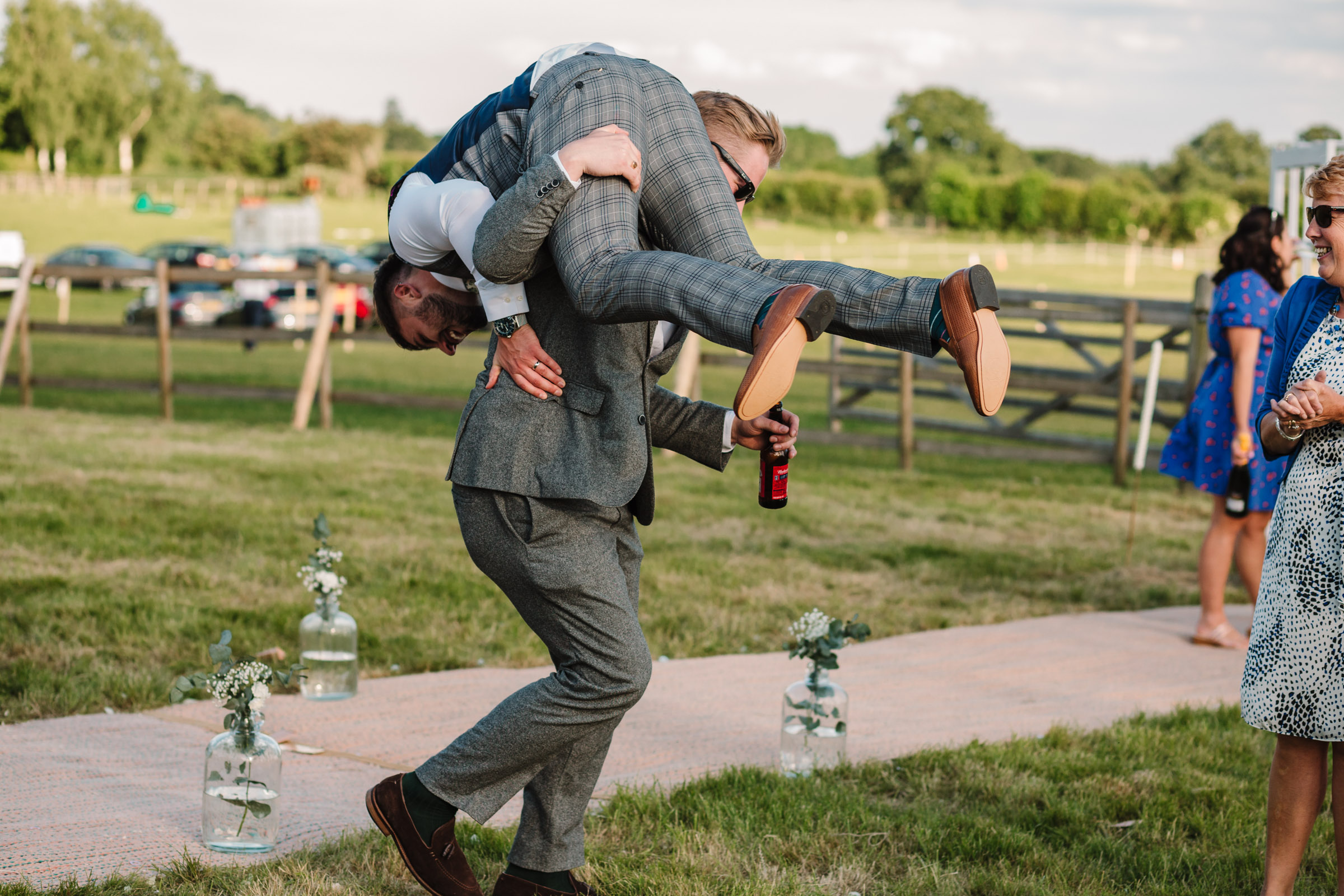 Groom being picked up by guest at wedding in kenilworth