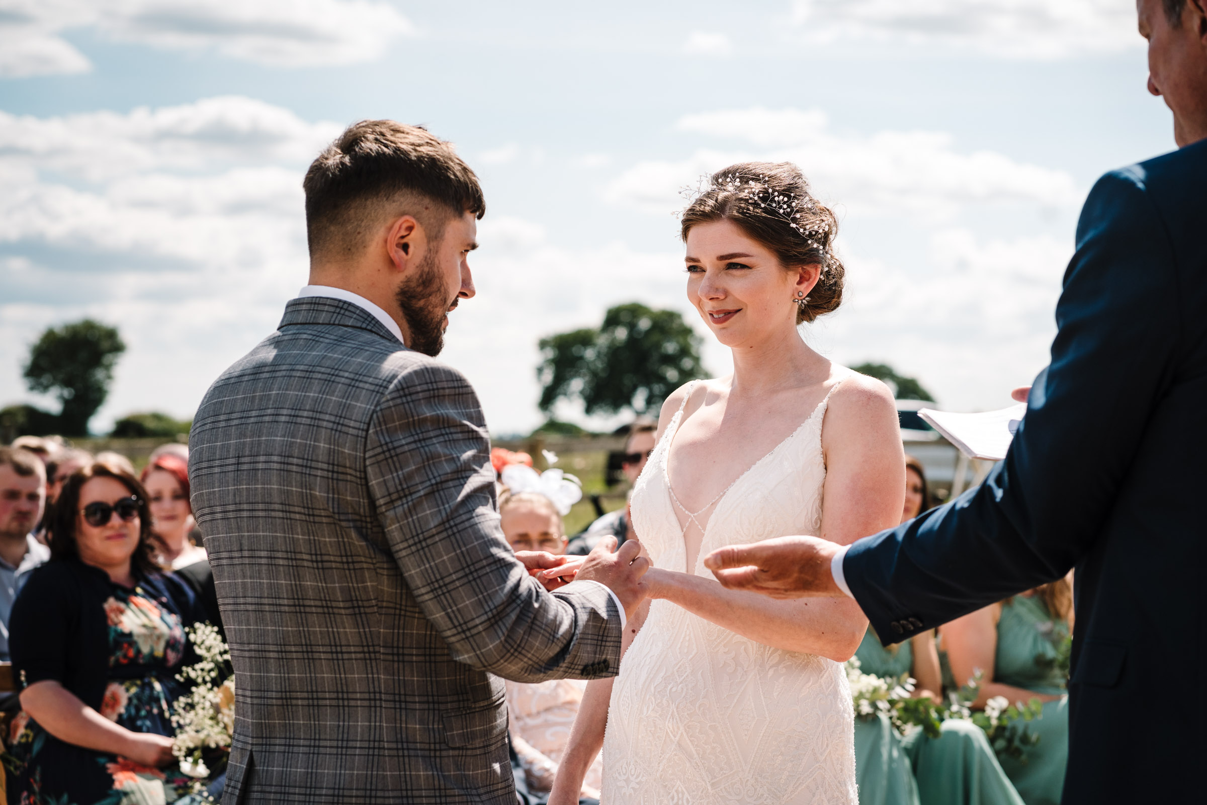 bride and groom exchanging rings, kenilworth wedding