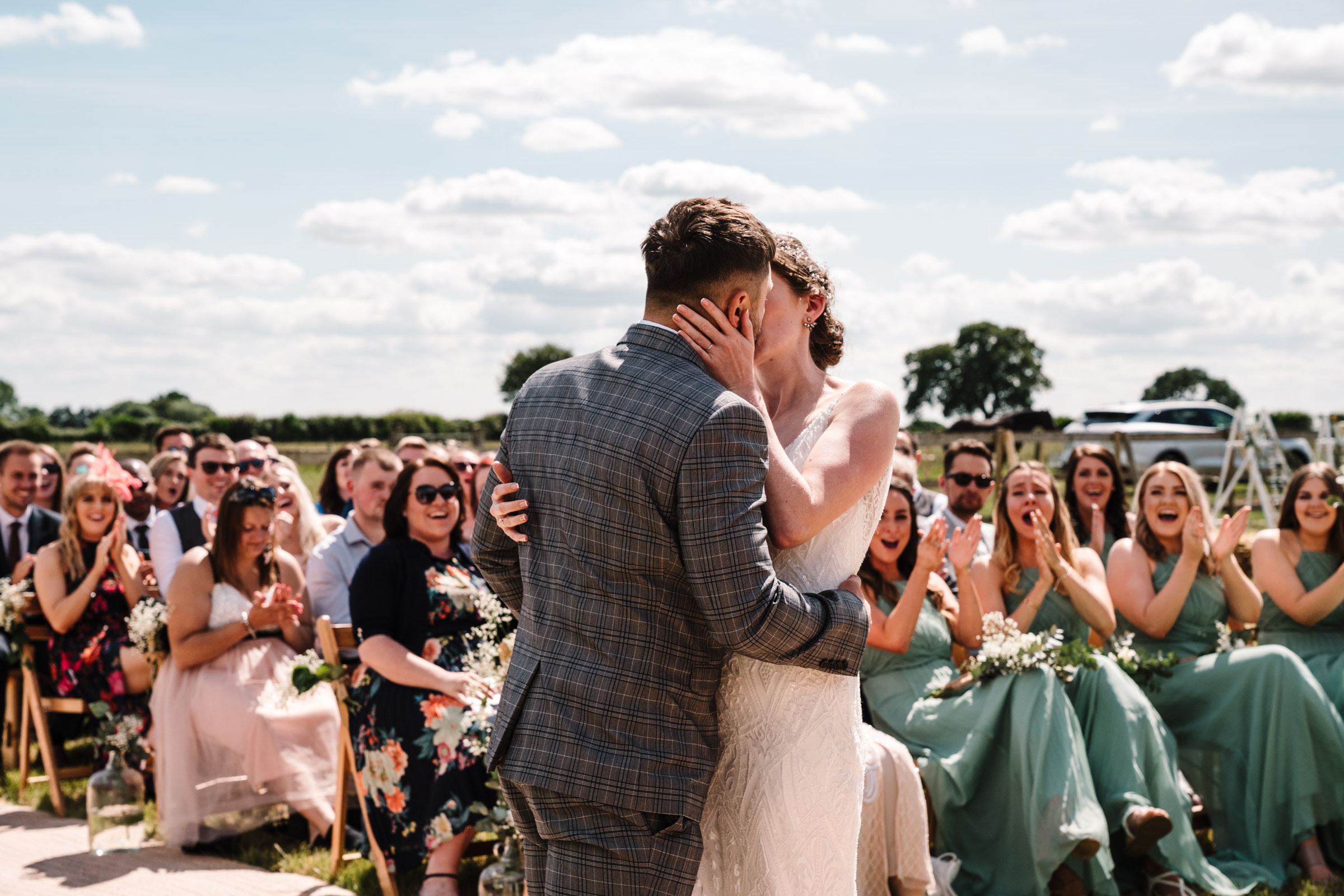 first kiss as husband and wife, outdoor wedding, kenilworth