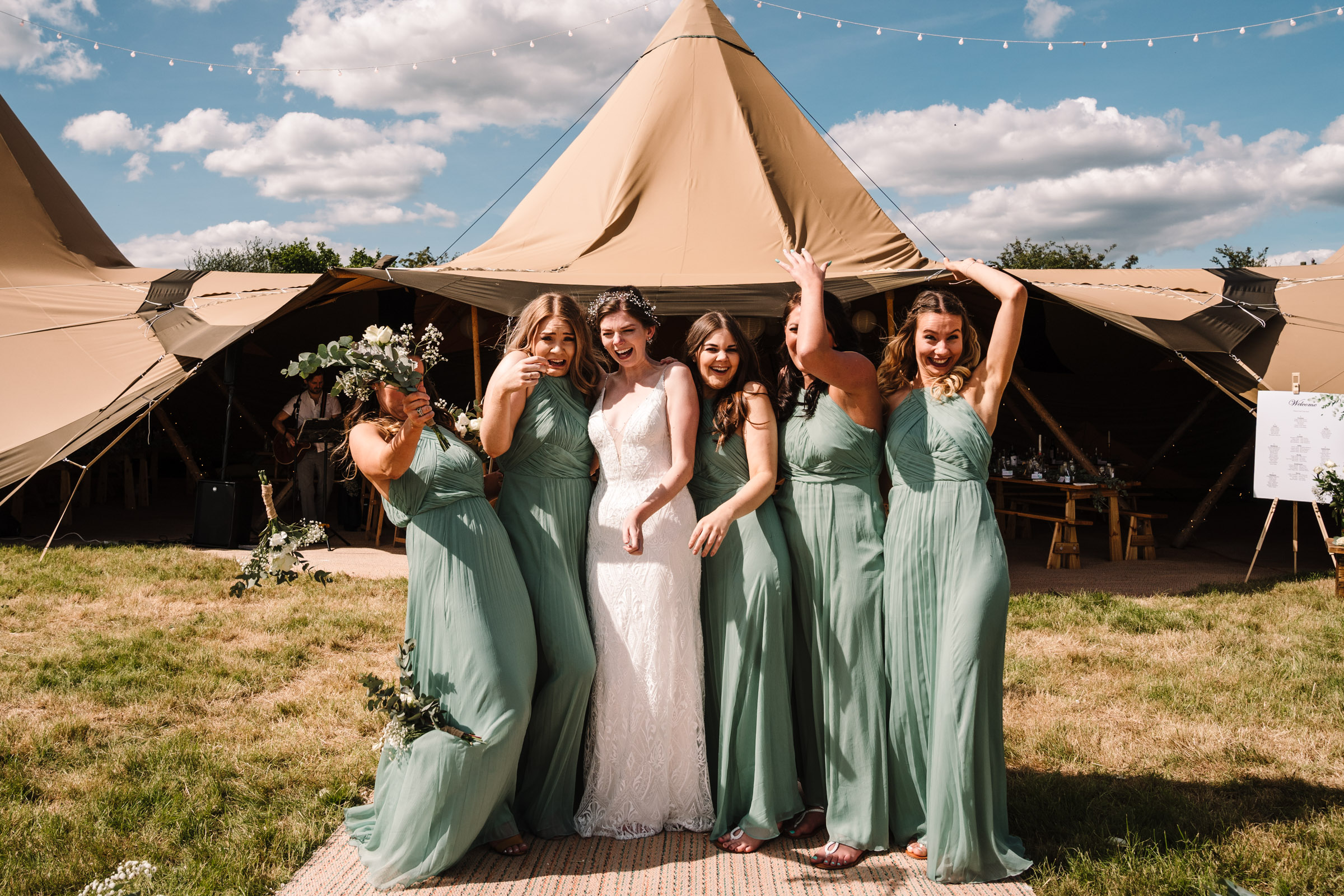 bride and bridesmaids outside tipi