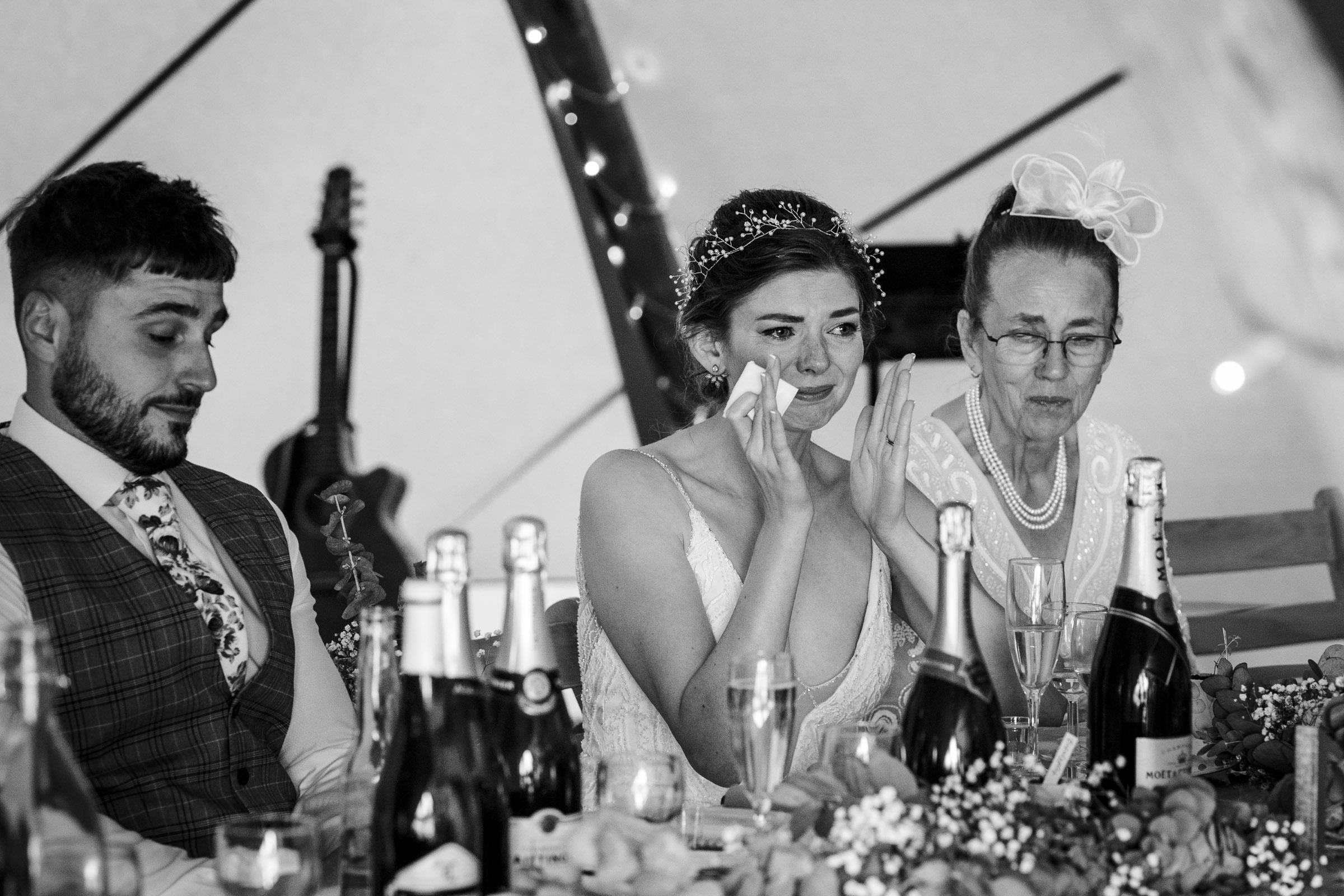 Bride crying during emotional speech at tipi wedding