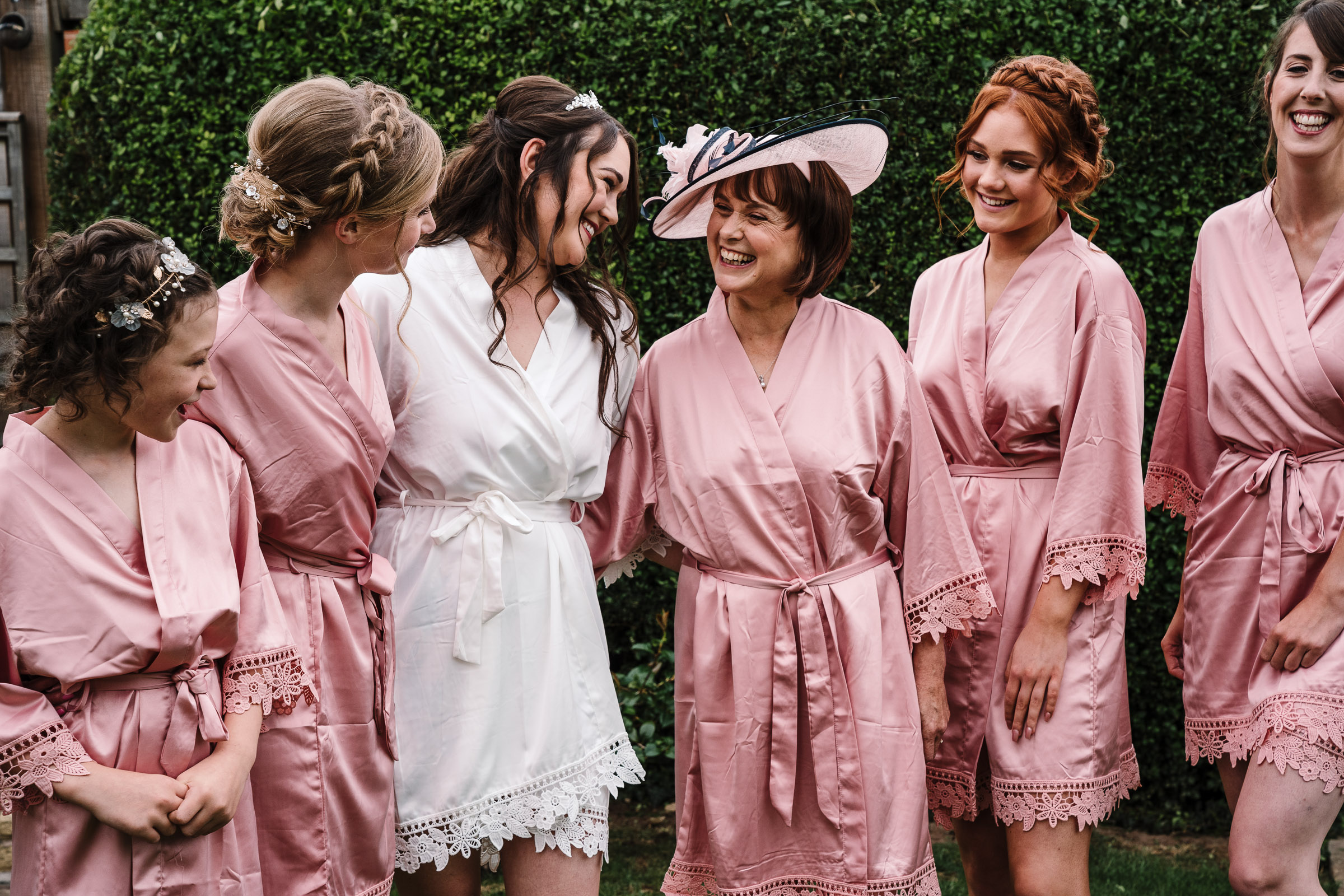 bride with Mum and bridesmaids in matching dressing gowns