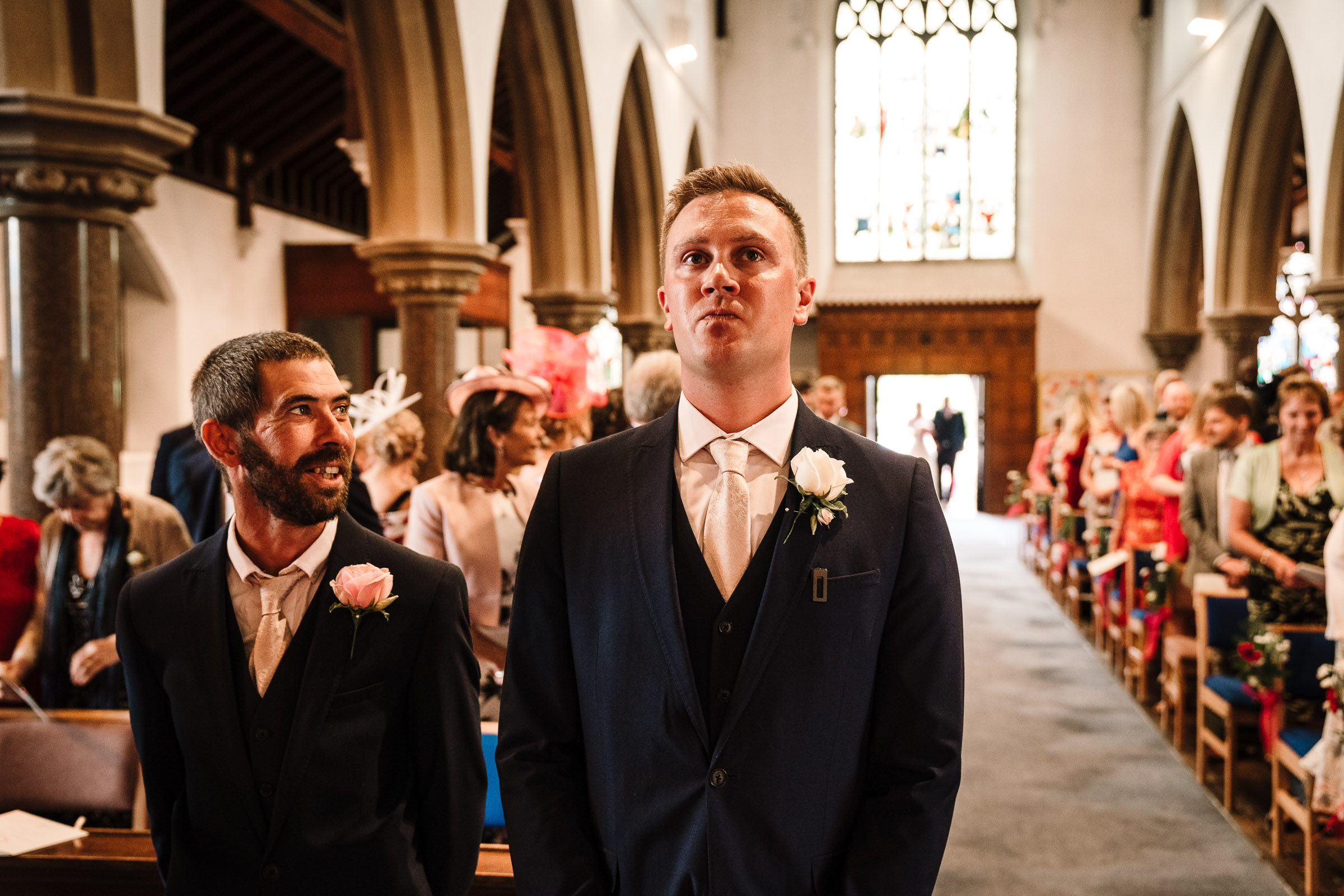 groom and best man waiting at the alter for bride to enter