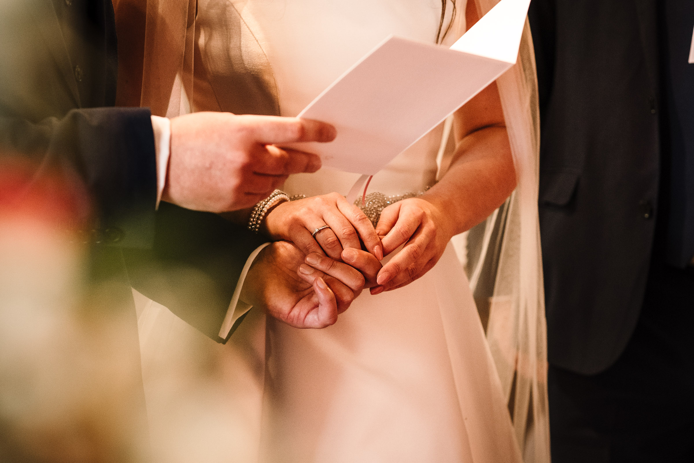 bride and groom holding hands during church wedding