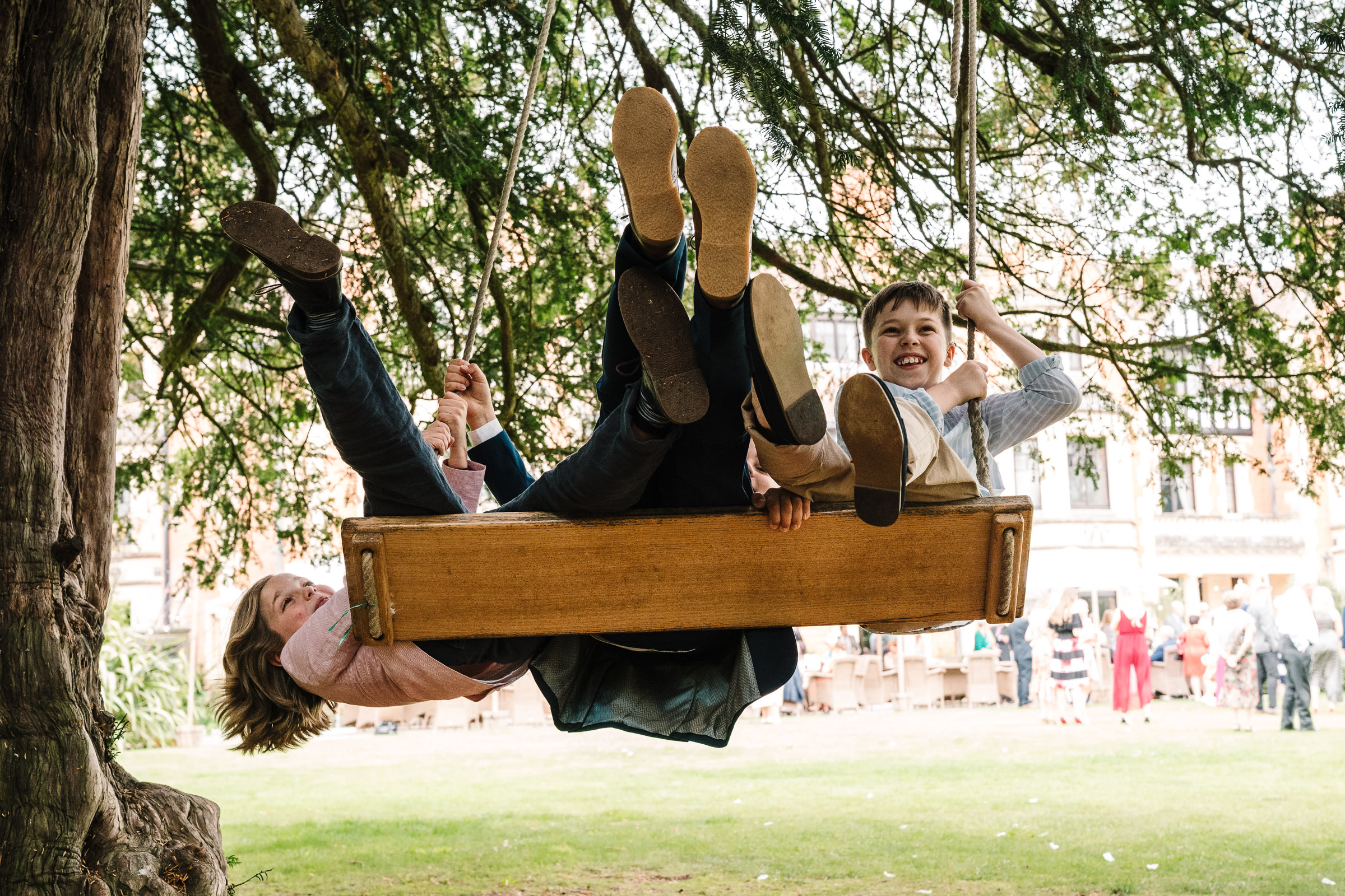 children playing on the swing at the wood norton wedding