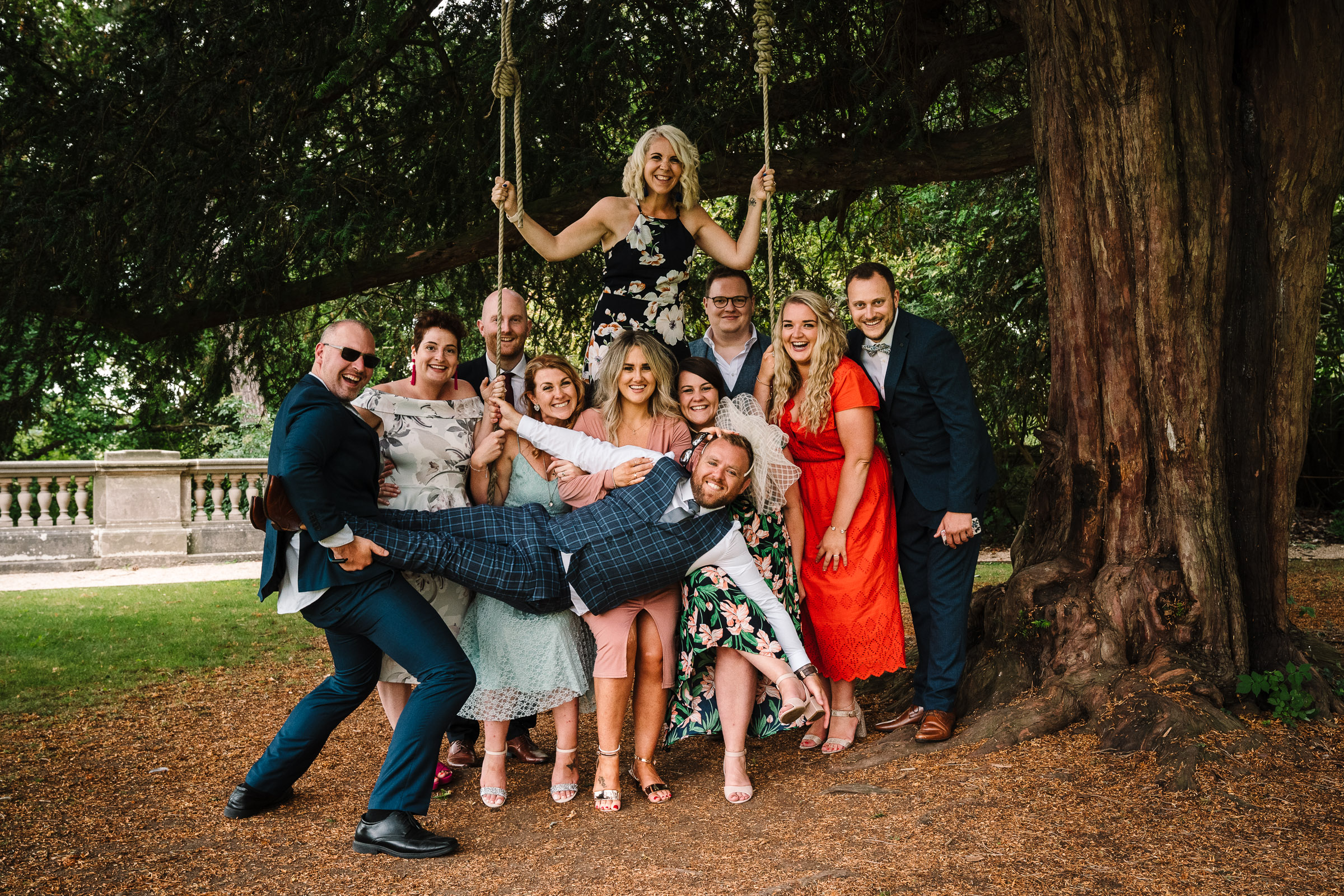 funny group photograph of guests on the swing at the wood norton