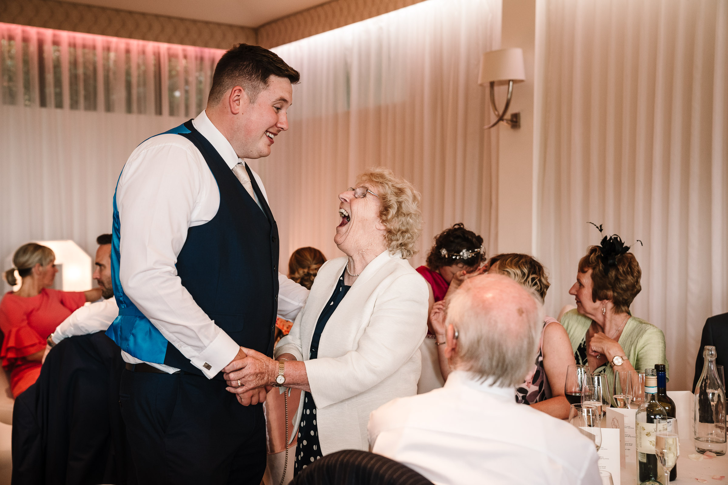 guests laughing during wedding breakfast at the wood norton wedding
