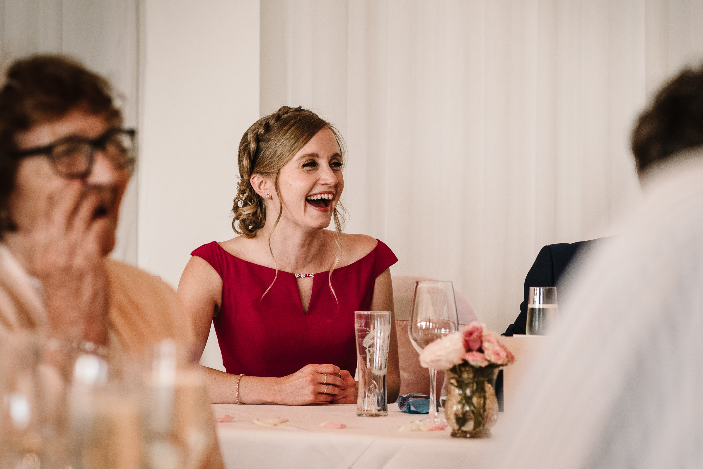 bridesmaid laughing at wedding speech