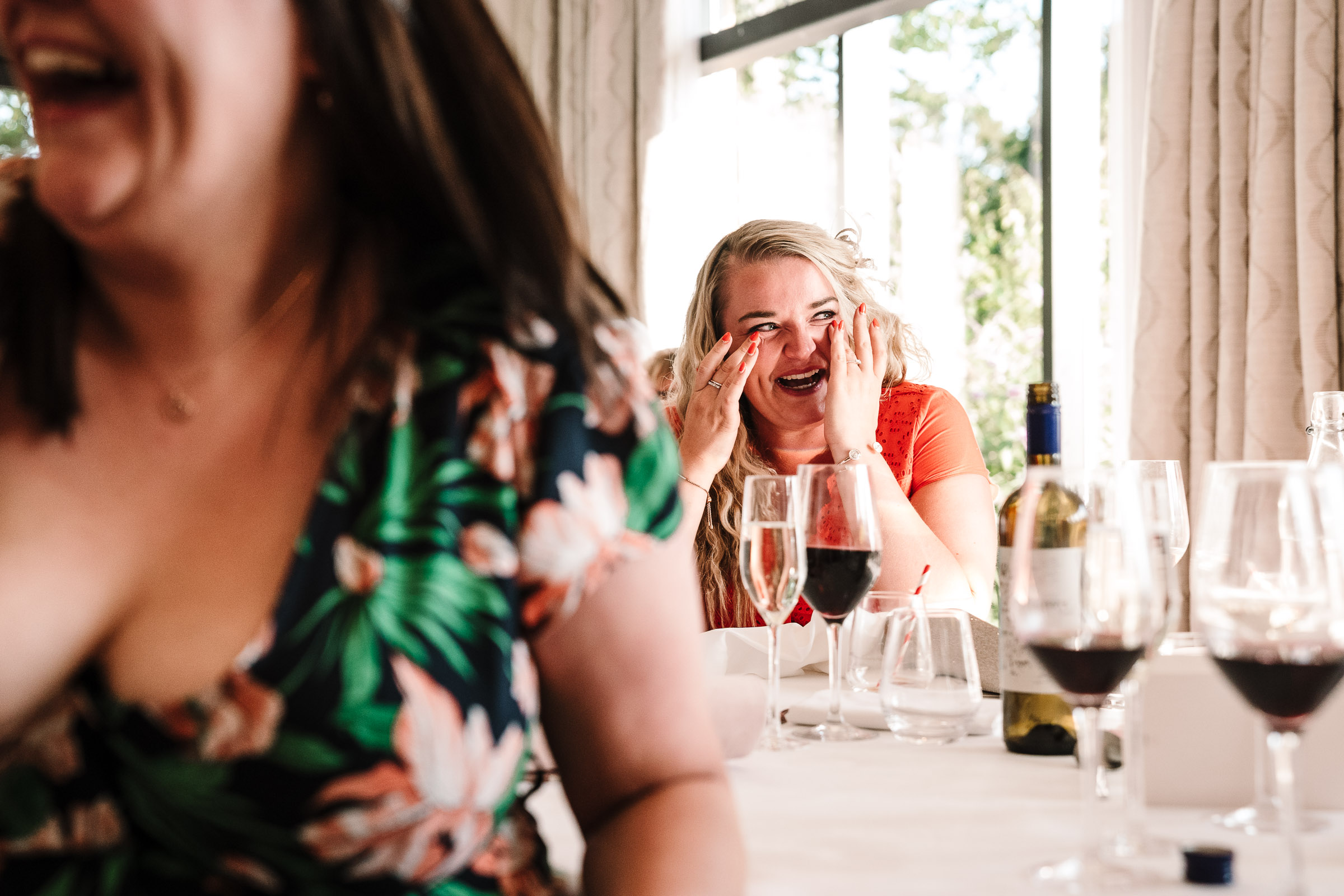 guest laughing at wedding speeches at the wood norton