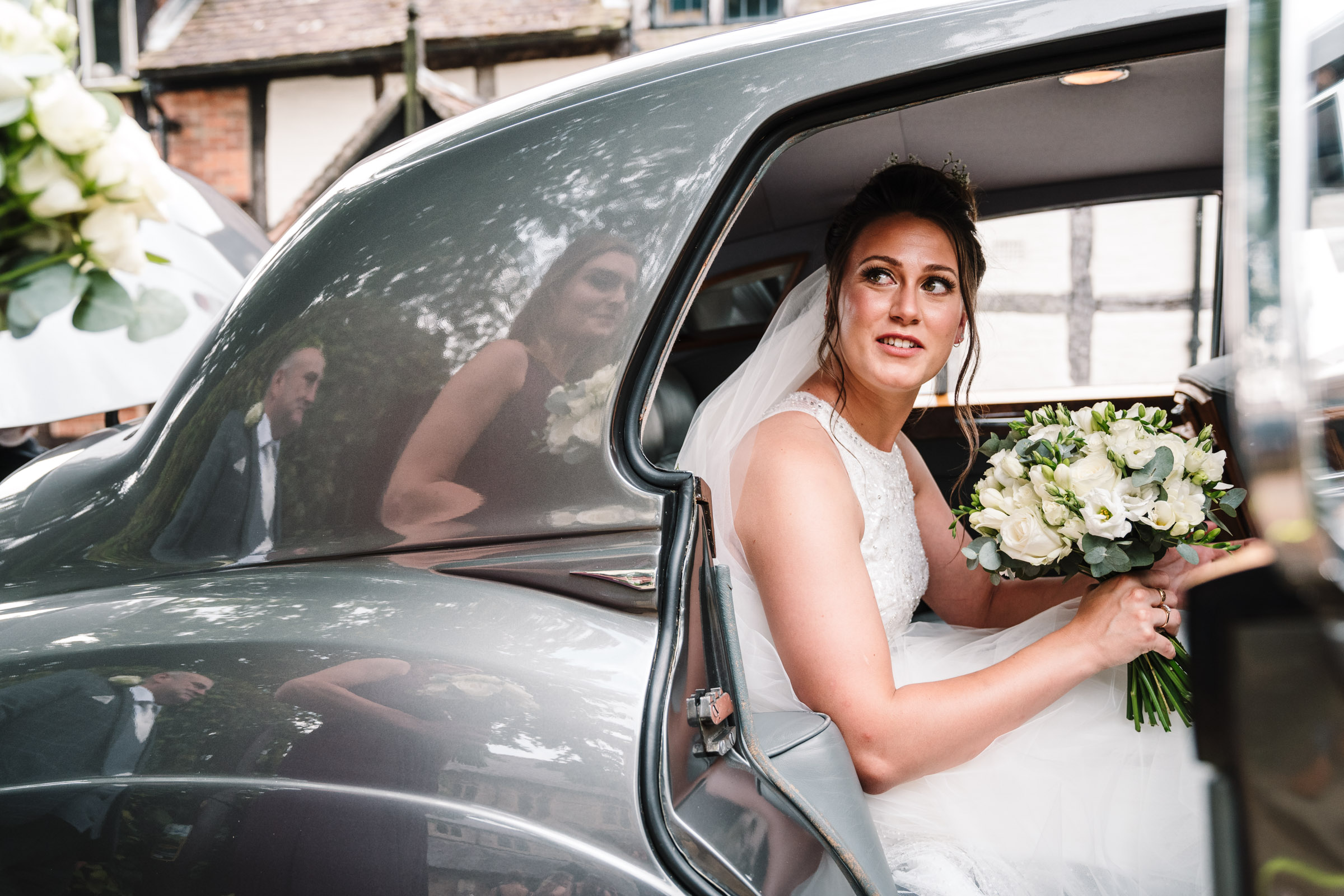 bride arriving at church, about to get out of wedding car